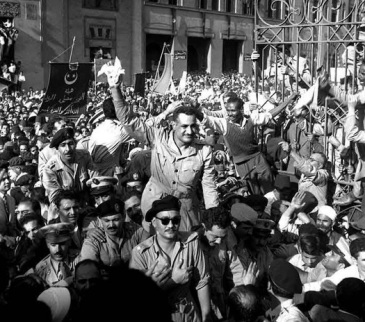 **Nasser greeted by crowds in Alexandria one day after his announcement of the British withdrawal and the assassination attempt against him, 27 October 1954. | Source: [1] at Bibliotheca Alexandrina | Wikimedia Commons