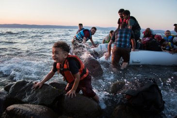 Syrian refugees arrive on the Greek island of Lesvos -- the main point of entry for refugees to Europe – after making the perilous crossing from Turkey in a rubber raft. UNHCR/Andrew McConnell