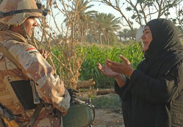 **Photo: A woman pleads to an Iraqi army soldier from 2nd Company, 5th Brigade, 2nd Iraqi Army Division to allow a suspected insurgent free during a raid near Tafaria, Iraq. | Author: U.S. Navy photo by Mass Communication Specialist 1st Class Jackey Bratt | Source: navy.mil | According to Wikimedia