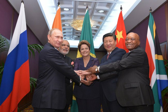 BRICS_heads_of_state_and_government_hold_hands_ahead_of_the_2014_G-20_summit_in_Brisbane,_Australia