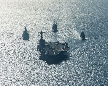 **The USS Carl Vinson and support ships deployed for combat operations in Syria and Iraq. | Author: United States Navy | Source: http://www.flickr.com/photos/navcent/15725597660 | Wikimedia Commons