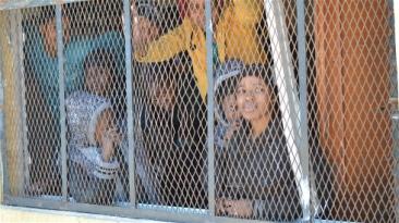 ***Photo: Mathieu Galtier/IRIN | Women at a migrant detention centre in Surnam, Libya