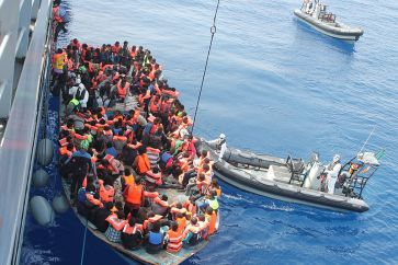 **Photo: Irish Naval personnel from the LÉ Eithne (P31) rescuing migrants as part of Operation Triton. | Author: Irish Defence Forces | Creative Commons Attribution 2.0 Generic license. | Wikimedia Commons