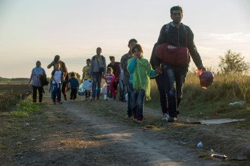 Refugees walking from Serbia, arrive at a 'collection point' in Hungary. UNHCR/Mark Henley