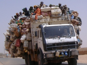 **A truck of smuggled migrants leaves Agadez to cross the Sahara desert into Libya and Algeria (Ibrahim Diallo Manzo/IRIN)