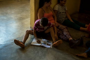 A boy works on his homework at the Todos posr Ellos family shelter in Tapachula
