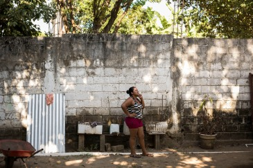 Diana Guadalupe Caballero, 29, from Honduras, talks to her family back home at the Buen Pastor shelter where she is staying while she awaits the outcome of her asylum application