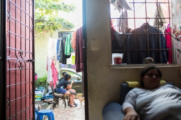 Milagro Del Socorro Romero Aguilar (right) is hosting Damaris Yamileth Turcios Lara and her children (left) in her family home while they apply for asylum in Mexico