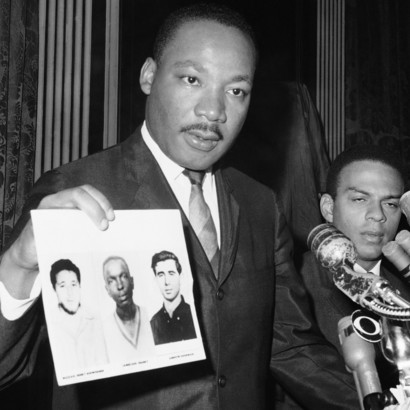 Martin-Luther-King-displays-pictures-of-three-civil-rights-workers-murdered-Cheney-Goodman-and