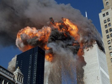 The-Twin-Towers-on-fire-just-before-collapsing