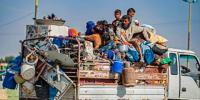 Syrian civilians fleeing Turkish bombardment on northeastern towns.jpg