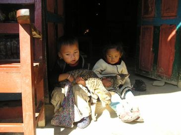 1024px-Nepalese-children-with-cats.jpg