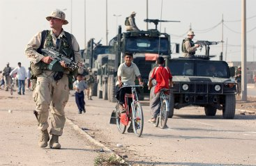 1024px-US_Navy_031016-N-3236B-043_A_marine_patrols_the_streets_of_Al_Faw,_Iraq